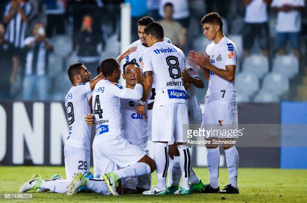 Ricardo Oliveira of Santos celebrates with his team mates after scoring their first goal during the match between Santos and Sporting Cristal for the...