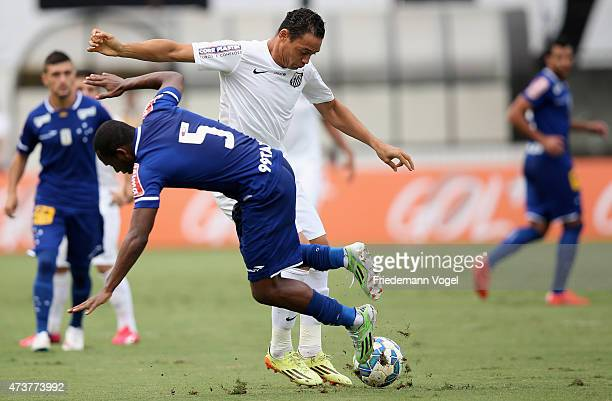 Ricardo Oliveira of Santos fights for the ball with Willians of Cruzeiro during the match between Santos and Cruzeiro for the Brazilian Series A 2015...
