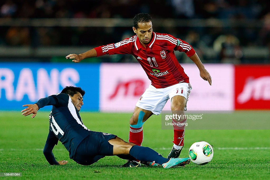 Ricardo Osorio (L) of Monterrey challenges Walid Soliman of Al-Ahly SC during the FIFA Club World Cup 3rd Place Match between Al-Ahly SC and CF Monterrey at International Stadium Yokohama on December 16, 2012 in Yokohama, Japan.