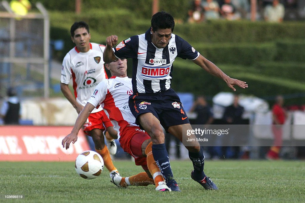 Ricardo Osorio (F) of Monterrey struggles for the ball with Danilo Veron (B) of Jaguares during a match as part of the Apertura 2010 at Tecnologico Stadium on August 28, 2010 in Monterrey, Mexico.