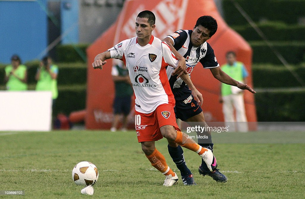 Ricardo Osorio (R) of Monterrey struggles for the ball with danilo Veron (L) Jaguares during a match as part of the Apertura 2010 at Tecnologico Stadium on August 28, 2010 in Monterrey, Mexico.