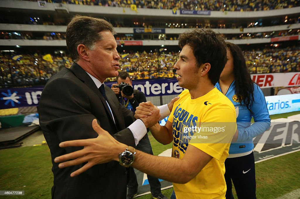 Ricardo Pelaez Sports Director of America celebrates with Formula One driver Sergio Perez after a Final second leg match between America and Tigres UANL as part of the Apertura 2014 Liga MX at Azteca Stadium on December 14, 2014 in Mexico City, Mexico.