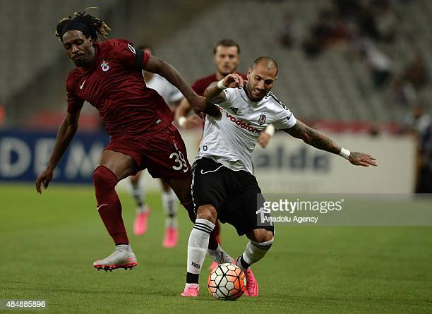 Ricardo Quaresma of Besiktas vies for the ball with Luis Cavanda of Trabzonspor during the Turkish Spor Toto Super League football match between...