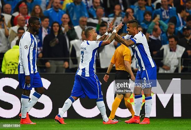 Ricardo Quaresma of FC Porto celebrates with team mate Danilo as he scores their second goal during the UEFA Champions League Quarter Final first leg...