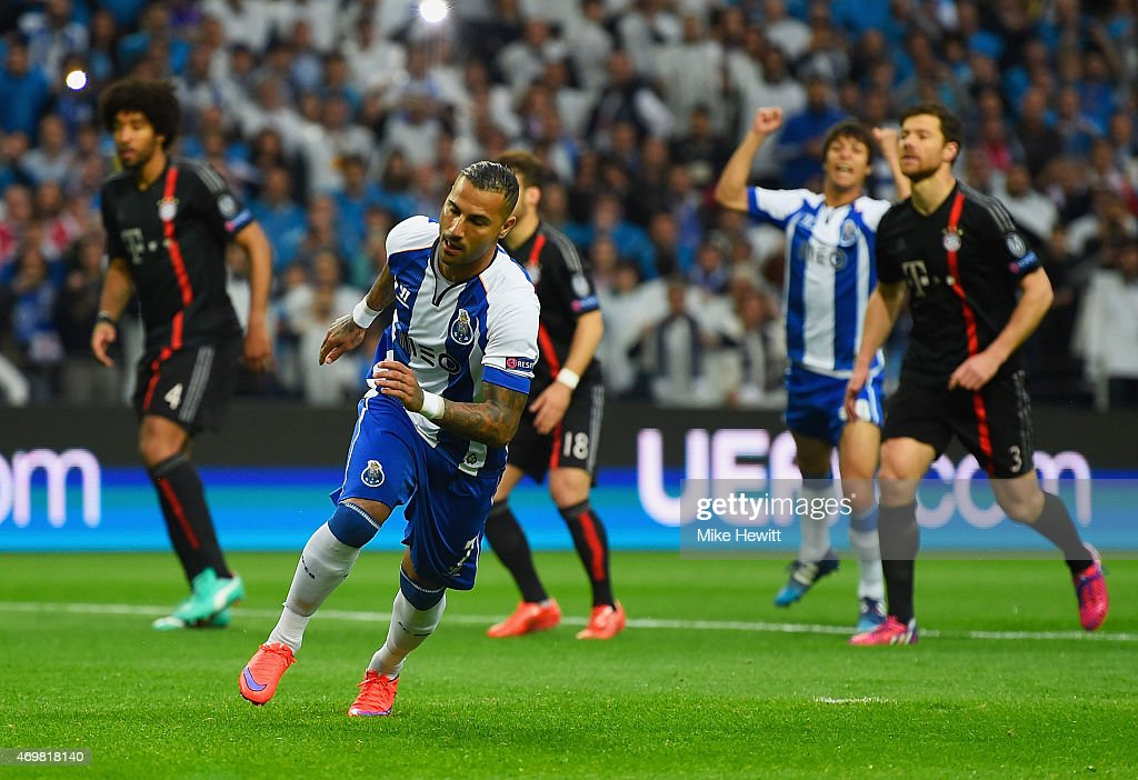 Ricardo Quaresma of FC Porto turns to celebrate as he scores their first goal from the penalty spot during the UEFA Champions League Quarter Final...