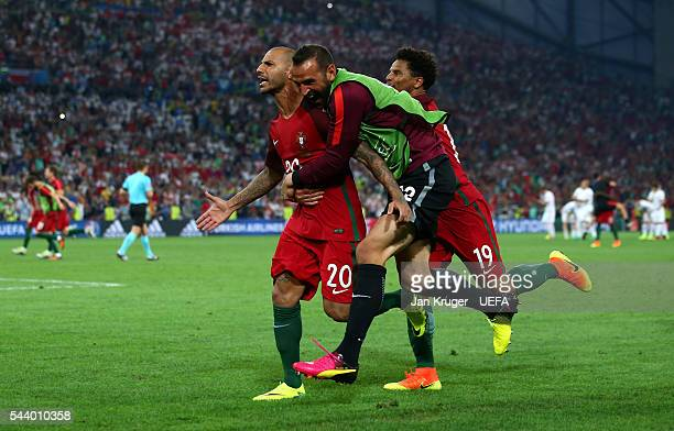 Ricardo Quaresma of Portugal celebrates scoring at the penalty shootout to win the game with his team mates Eduardo and Eliseu during the UEFA EURO...
