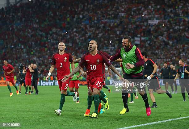 Ricardo Quaresma of Portugal celebrates scoring at the penalty shootout to win the game with his team mates after the UEFA EURO 2016 quarter final...