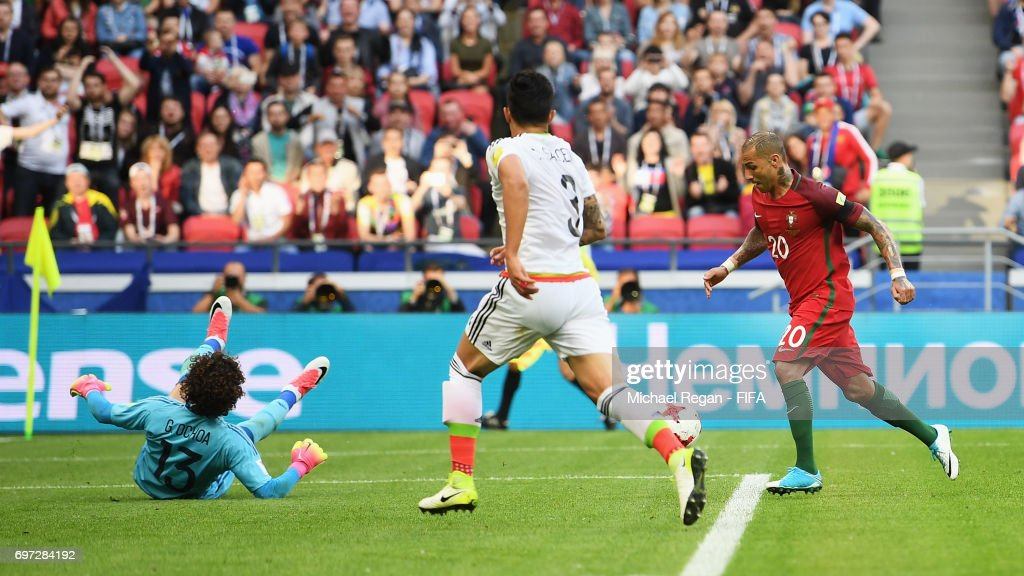 Ricardo Quaresma of Portugal scores his sides first goal past Guillermo Ochoa of Mexico during the FIFA Confederations Cup Russia 2017 Group A match between Portugal and Mexico at Kazan Arena on June 18, 2017 in Kazan, Russia.