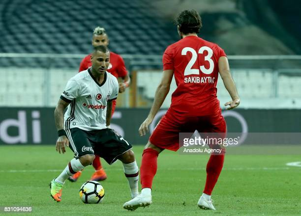Ricardo Querasma of Besiktas is in action against Aytac Sakib of Antalyaspor during a Turkish Spor Toto Super Lig soccer match between Besiktas JK...