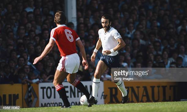 Ricardo 'Ricky' Villa of Spurs takes on Martin Buchan of Manchester United during a Division One match between Tottenham Hotspur and Manchester...