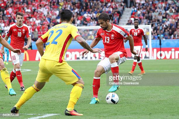 Ricardo Rodríguez of Switzerland controls the ball against Cristian Sapunaru of Romania during the UEFA EURO 2016 Group A match between Romania and...