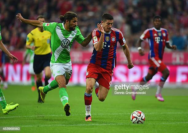 Ricardo Rodríguez of VfL Wolfsburg and Robert Lewandowski of Bayern Muenchen battle for the ball during the Bundesliga match between FC Bayern...