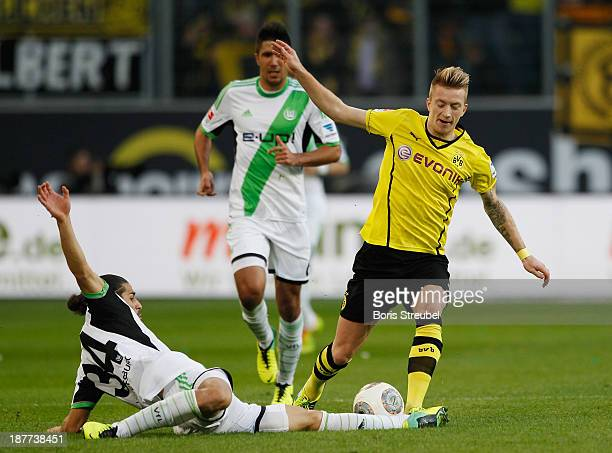 Ricardo Rodríguez of Wolfsburg challenges Marco Reus of Borussia Dortmund during the Bundesliga match between VfL Wolfsburg and Borussia Dortmund at...