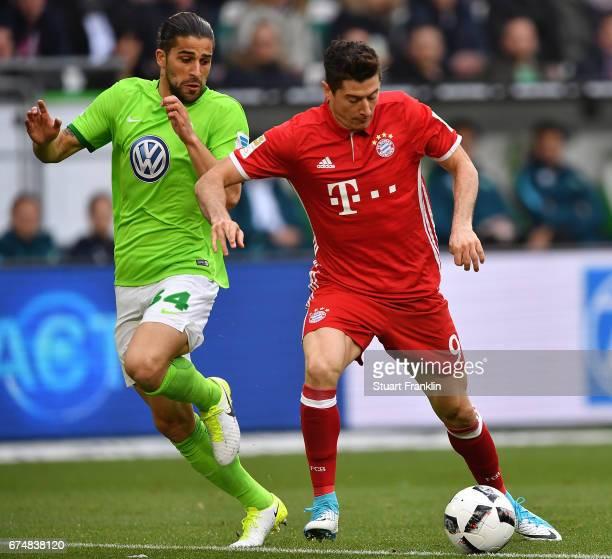 Ricardo Rodrguez of Wolfsburg challenges Robert Lewandowski of Muenchen during the Bundesliga match between VfL Wolfsburg and Bayern Muenchen at...