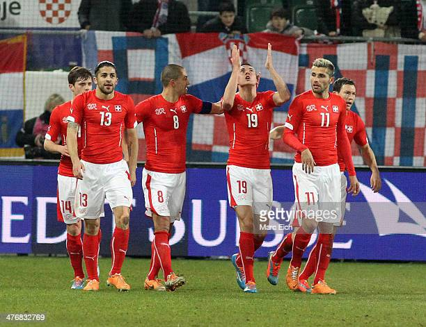 Ricardo Rodriguez Goekhan Inler Josip Drmic and Valon Behrami of Switzerland celebrate the first goal of the match during the international friendly...