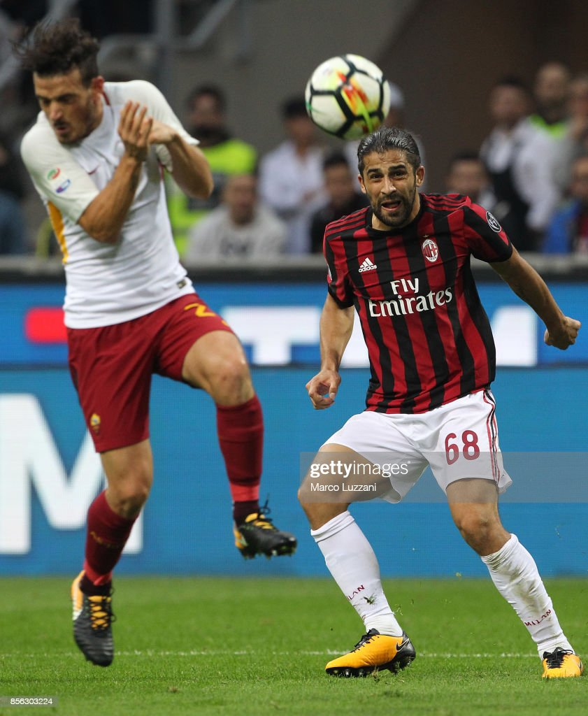 Ricardo Rodriguez (R) of AC Milan kicks a ball during the Serie A match between AC Milan and AS Roma at Stadio Giuseppe Meazza on October 1, 2017 in Milan, Italy.
