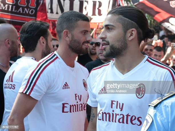 Ricardo Rodriguez of AC Milan with his teammate Mateo Pablo Musacchio greet the fans prior to the AC Milan training session at the club's training...