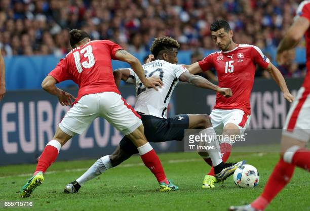 Ricardo Rodriguez of Switzerland and Kingsley Coman of France and Blerim Dzemaili of Switzerland battle for the ball during the UEFA Euro 2016 Group...