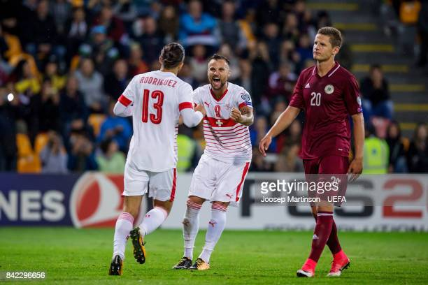 Ricardo Rodriguez of Switzerland celebrates his goal with Haris Seferovic of Switzerland during the FIFA 2018 World Cup Qualifier between Latvia and...