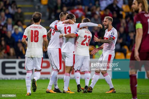 Ricardo Rodriguez of Switzerland celebrates his goal with team mates during the FIFA 2018 World Cup Qualifier between Latvia and Switzerland at...