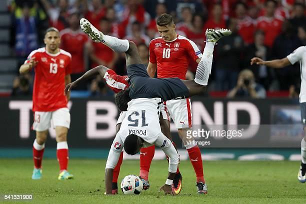 Ricardo Rodriguez of Switzerland Paul Pogba of France Breel Embolo of Switzerland Granit Xhaka of Switzerland during the UEFA EURO 2016 Group A group...