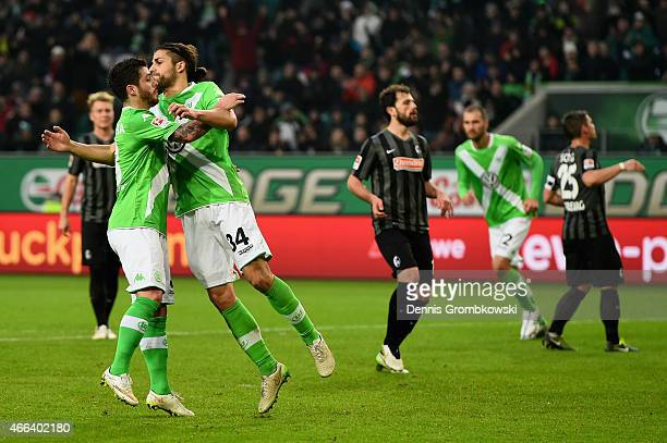 Ricardo Rodriguez of VfL Wolfsburg celebrates as he scores the second goal from a penalty during the Bundesliga match between VfL Wolfsburg and SC...