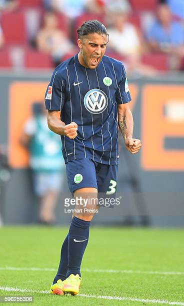 Ricardo Rodriguez of VfL Wolfsburg celebrates his team's second goal during the Bundesliga match between FC Augsburg and VfL Wolfsburg at WWK Arena...