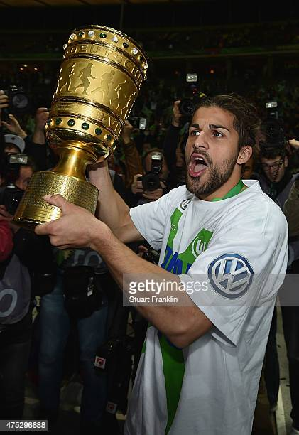 Ricardo Rodriguez of VfL Wolfsburg celebrates with the trophy following the DFB Cup Final match between Borussia Dortmund and VfL Wolfsburg at...
