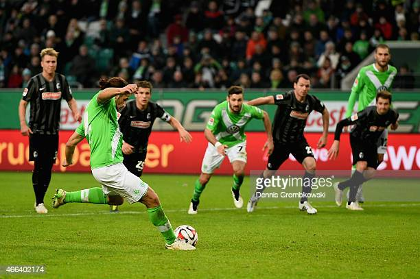 Ricardo Rodriguez of VfL Wolfsburg scores the second goal from the penalty spot during the Bundesliga match between VfL Wolfsburg and SC Freiburg at...