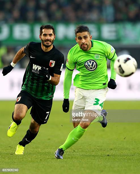Ricardo Rodriguez of Wolfsburg and Halil Altintop of Augsburg battle for the ball during the Bundesliga match between VfL Wolfsburg and FC Augsburg...