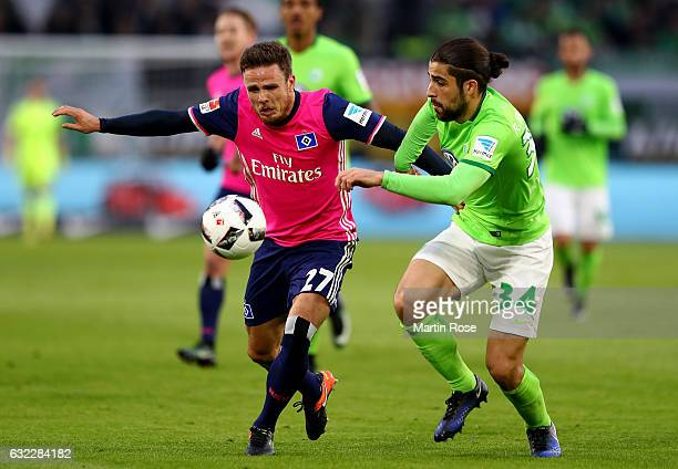 Ricardo Rodriguez of Wolfsburg and Nicolai Mueller of Hamburg battle for the ball during the Bundesliga match between VfL Wolfsburg and Hamburger SV...