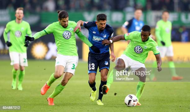 Ricardo Rodriguez of Wolfsburg and Riechedly Bazoer of Wolfsburg challenge Kerem Demirbag of Hoffenheim during the Bundesliga match between VfL...