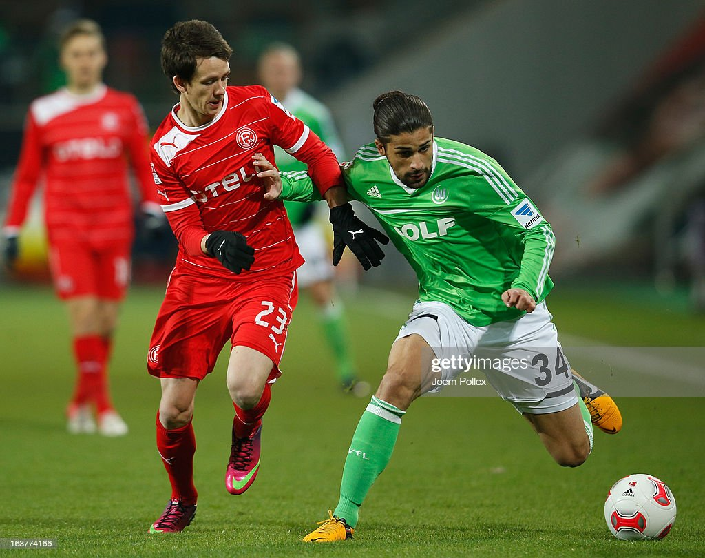 Ricardo Rodriguez (R) of Wolfsburg and Robbie Kruse of Duesseldorf compete for the ball during the Bundesliga match between VfL Wolfsburg and Fortuna Duesseldorf 1895 at Volkswagen Arena on March 15, 2013 in Wolfsburg, Germany.