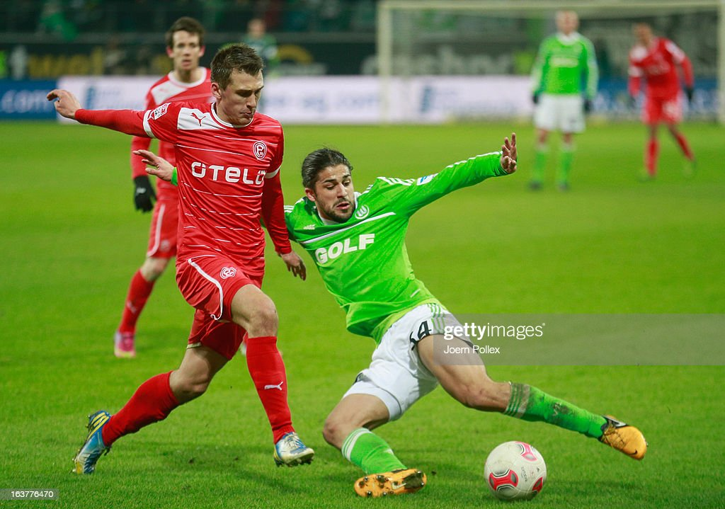 Ricardo Rodriguez (R) of Wolfsburg and <a gi-track='captionPersonalityLinkClicked' href=/galleries/search?phrase=Robert+Tesche&family=editorial&specificpeople=4218513 ng-click='$event.stopPropagation()'>Robert Tesche</a> of Duesseldorf compete for the ball during the Bundesliga match between VfL Wolfsburg and Fortuna Duesseldorf 1895 at Volkswagen Arena on March 15, 2013 in Wolfsburg, Germany.