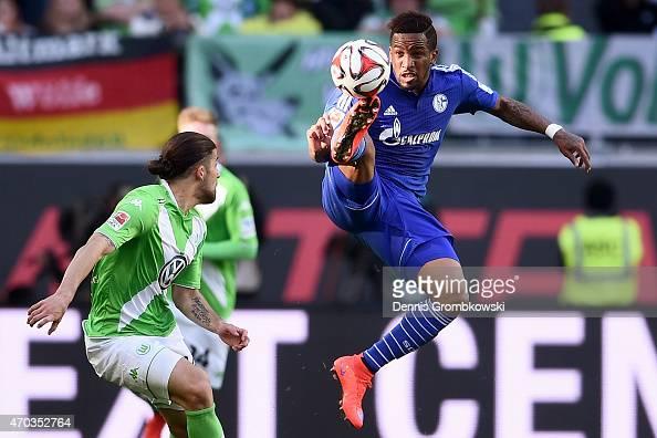 Ricardo Rodriguez of Wolfsburg battles for the ball with Jefferson Farfan of Schalke during the Bundesliga match between VfL Wolfsburg and FC Schalke...
