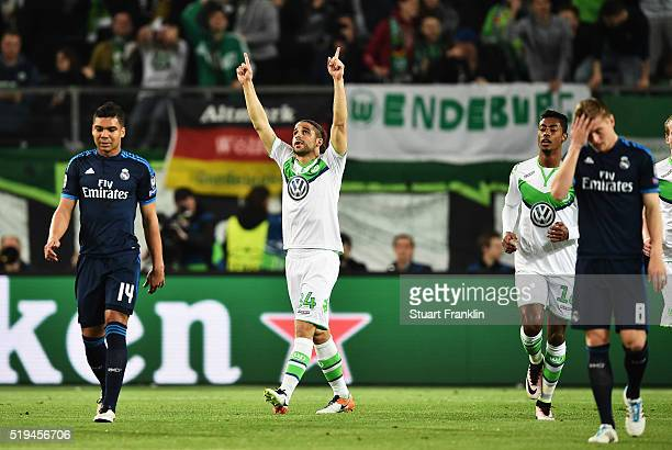 Ricardo Rodriguez of Wolfsburg celebrates scoring his goal with teamates during the UEFA Champions League Quarter Final First Leg match between VfL...
