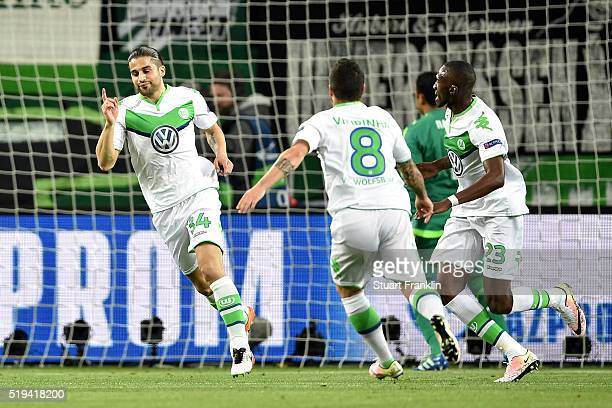 Ricardo Rodriguez of Wolfsburg celebrates scoring his team's first goal with his team mates during the UEFA Champions League Quarter Final First Leg...