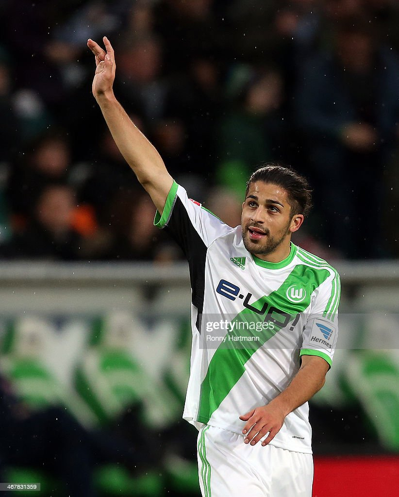 Ricardo Rodriguez (R) of Wolfsburg celebrates scoring his teams opening goal with <a gi-track='captionPersonalityLinkClicked' href=/galleries/search?phrase=Christian+Traesch&family=editorial&specificpeople=5482851 ng-click='$event.stopPropagation()'>Christian Traesch</a> of Wolfsburg during the Bundesliga match between VfL Wolfsburg and 1. FSV Mainz 05 at Volkswagen Arena on February 08, 2014 in Wolfsburg, Germany.