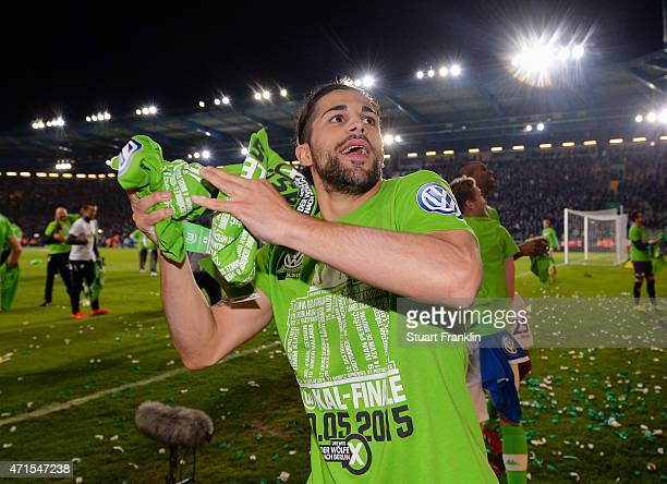 Ricardo Rodriguez of Wolfsburg celebrates with the fans by throwing shirts to them after the DFB Cup Semi Final match between Arminia Bielefeld and...