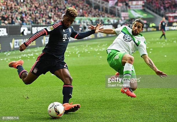 Ricardo Rodriguez of Wolfsburg challenges Kingsley Coman of Muenchen during the Bundesliga match between VfL Wolfsburg and FC Bayern Muenchen at...