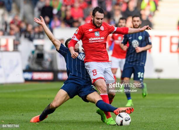 Ricardo Rodriguez of Wolfsburg challenges Levin Oeztunali of Mainz 05 during the Bundesliga match between 1 FSV Mainz 05 and VfL Wolfsburg at Opel...