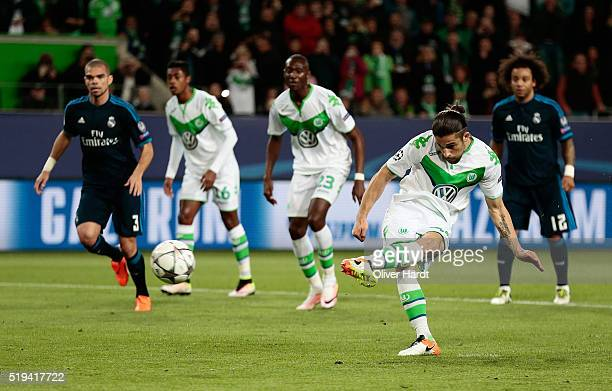 Ricardo Rodriguez of Wolfsburg converts the penalty to score his team's first goal during the UEFA Champions League Quarter Final First Leg match...