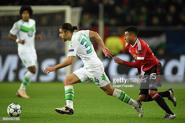 Ricardo Rodriguez of Wolfsburg goes past Jesse Lingard of Manchester United during the UEFA Champions League group B match between VfL Wolfsburg and...