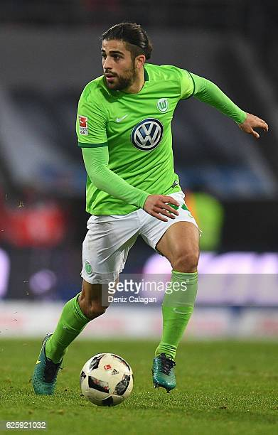 Ricardo Rodriguez of Wolfsburg handles the ball during the Bundesliga match between FC Ingolstadt 04 and VfL Wolfsburg at Audi Sportpark on November...