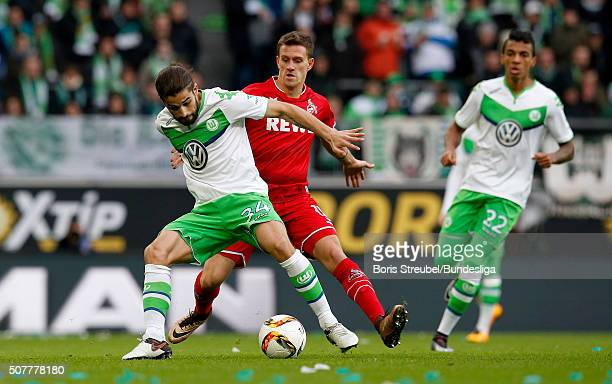 Ricardo Rodriguez of Wolfsburg is challenged by Simon Zoller of Koeln during the Bundesliga match between VfL Wolfsburg and 1 FC Koeln at Volkswagen...