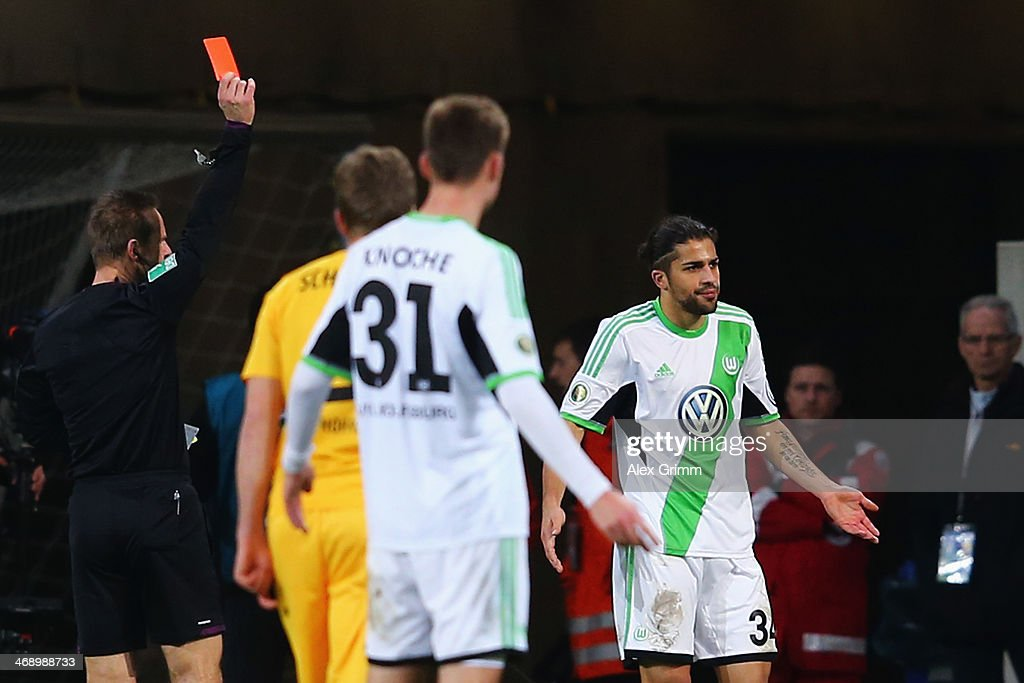 Ricardo Rodriguez of Wolfsburg is sent off by referee <a gi-track='captionPersonalityLinkClicked' href=/galleries/search?phrase=Peter+Gagelmann&family=editorial&specificpeople=808542 ng-click='$event.stopPropagation()'>Peter Gagelmann</a> during the DFB Cup quarterfinal match between 1899 Hoffenheim and VfL Wolfsburg at Wirsol Rhein-Neckar-Arena on February 12, 2014 in Sinsheim, Germany.