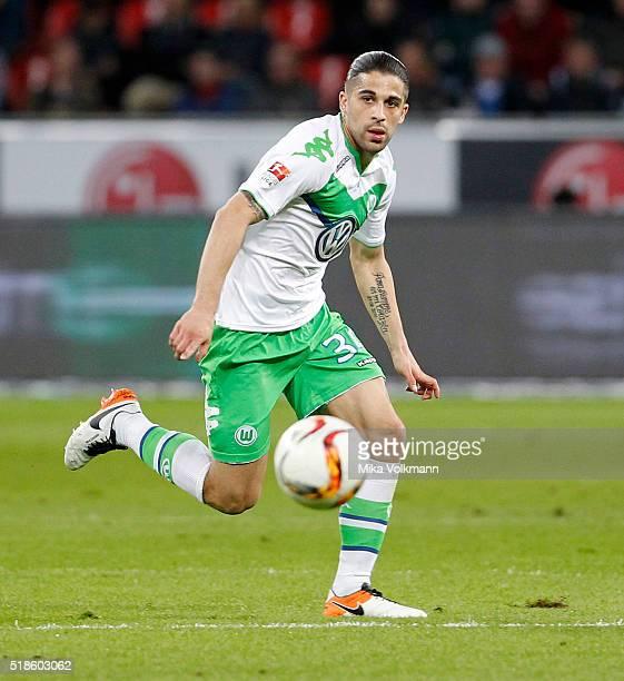 Ricardo Rodriguez of Wolfsburg runs with the ball during the Bundesliga match between Bayer Leverkusen and VFL Wolfsburg at BayArena on April 1 2016...