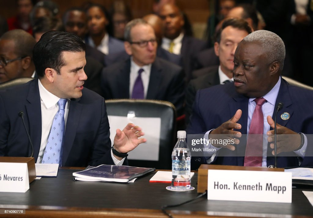 Ricardo Rossello Nevares, (L), Governor of the Commonwealth of Puerto Rico, speaks to Kenneth Mapp, governor of the US Virgin Islands, during a Senate Energy and Natural Resources Committee hearing on hurricane recovery efforts in Puerto Rico and the US Virgin Islands, on Capitol Hill November 14, 2017 in Washington, DC.