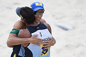 Ricardo Santos and Emanuel Rego celebrate a victory after a men's quarterfinals match on Day 2 of the Banco do Brasil Beach Volleyball Open at Icarai...