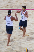Ricardo Santos and Pedro Cunha of Brazil celebrate during the Men's Beach Volleyball preliminary match between the Brazil and Canada on Day 5 of the...